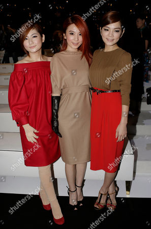 From left, Ella Chen, Hebe Tien and Selina Jen of the Taiwanese pop group S.H.E., pose prior to the start of the the Gucci women's Spring-Summer 2013 collection that was presented in Milan, Italy, Wednesday, Sept.19, 2012