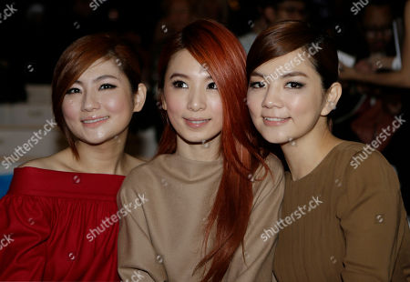 Stock Picture of From left, Ella Chen, Hebe Tien and Selina Jen of the Taiwanese pop group S.H.E., pose prior to the start of the the Gucci women's Spring-Summer 2013 collection that was presented in Milan, Italy, Wednesday, Sept.19, 2012