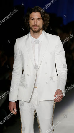 Argentine model Martin Mica, 27, wears a creation part of the Just Cavalli women's Fall-Winter 2012-2013 collection that was presented in Milan, Italy