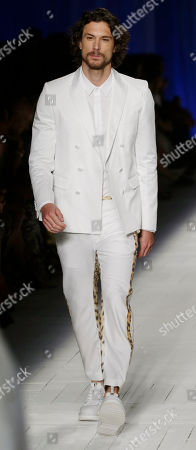 Argentine model Martin Mica, 27, wears a creation part of the Just Cavalli Fall-Winter 2012-2013 collection that was presented in Milan, Italy