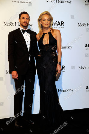 Martin Mica and Sharon Stone attend the Amfar charity event, part of the Fashion Week in Milan, Italy, Saturday, Sept.22, 2012