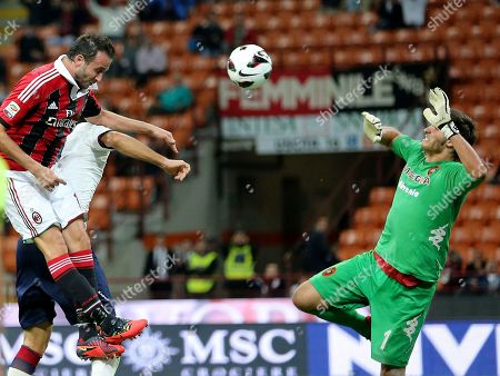 Giampaolo Pazzini, Michael Agazzi AC Milan forward Giampaolo Pazzini, left, tries to score as Cagliari goalkeeper Michael Agazzi saves the ball during the Serie A soccer match between AC Milan and Cagliari at the San Siro stadium in Milan, Italy