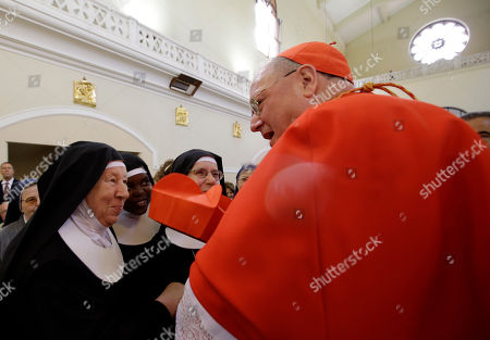 Cardinal Timothy Michael Dolan, archbishop of New York, is greeted by nuns as he takes possession of the title of Nostra Signora di Guadalupe church in Rome