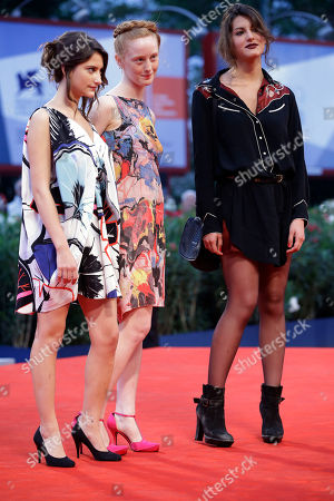 Actresses Lola Creton, India Salvor Menuez, and Carole Combes arrive on the red carpet for the film 'Apres Mai' at the 69th edition of the Venice Film Festival in Venice, Italy