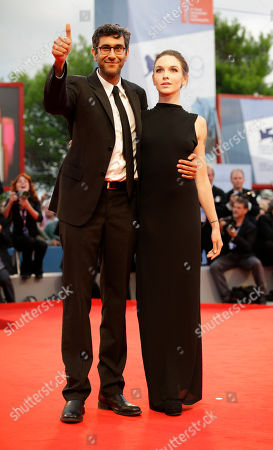 Ramin Bahrani, Hallie Elizabeth Newton Director Ramin Bahrani, left, and screenwriter Hallie Elizabeth Newton arrive for the premiere of the film 'At Any Price' during the 69th edition of the Venice Film Festival in Venice, Italy