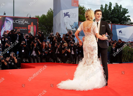 Maika Monroe, Zac Efron Actors Zac Efron, right, Maika Monroe, second left, and screenwriter Hallie Elizabeth Newton, back left, arrive for the premiere of the film 'At Any Price' during the 69th edition of the Venice Film Festival in Venice, Italy