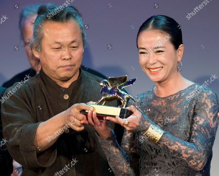 KIM Ki-duk, CHO Min-soo Director KIM Ki-duk, left, and actress CHO Min-soo show their Golden Lion for best movie for the film 'Pieta' at the 69th edition of the Venice Film Festival in Venice, Italy