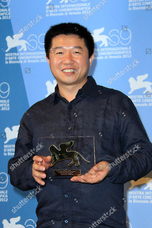 Yoo Min-young Wang Bing with Orizzonti Award for Best Short Film for ' Cho-De' at the awards photo call during the 69th edition of the Venice Film Festival in Venice, Italy