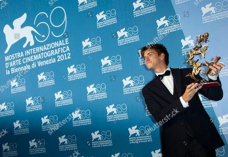 Fabrizio Falco Fabrizio Falco with his Best New Young Actor Award for his role in the films 'Bella Addormentata' and 'E Stato Il Figlio' at the awards photo call during the 69th edition of the Venice Film Festival in Venice, Italy