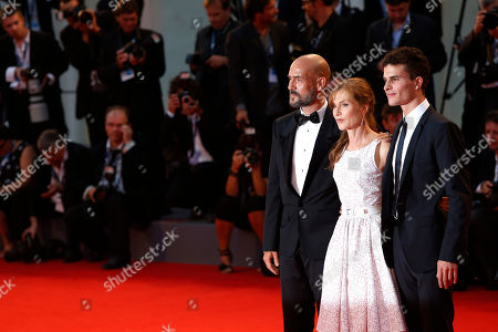 Stock Picture of Gian MarcoTognazzi, Isabelle Huppert, Brenno Placido From left, actors Gian MarcoTognazzi, Isabelle Huppert, and Brenno Placido arrive for the premiere of the film 'Bella Addormentata' (Sleeping Beauty) at the 69th edition of the Venice Film Festival in Venice, Italy