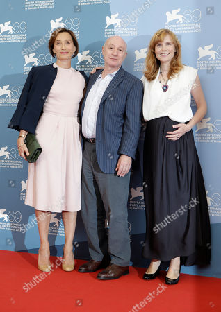 Isabelle Carre, Pascal Bonitzer, Kristin Scott Thomas From left, actress Kristin Scott Thomas, director Pascal Bonitzer and actress Isabelle Carre pose at the photo call for the movie 'Cherchez Hortense' at the 69th edition of the Venice Film Festival in Venice, Italy