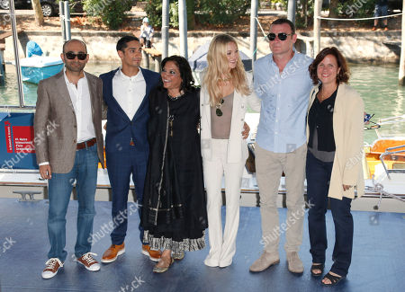 Mohsin Hamid, Riz Ahmed, Mira Nair, Kate Hudson, Liev Schreiber, Lydia Dean Pilcher From left, writer Mohsin Hamid, actor Riz Ahmed, director Mira Nair, actors Kate Hudson, Liev Schreiber and producer Lydia Dean Pilcher arrive for the press conference of the film 'The Reluctant Fundamentalist' at the 69th edition of the Venice Film Festival in Venice, Italy