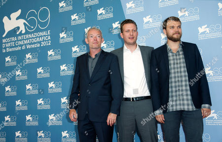 Soren Malling, Tobias Lindholm, Johan Philip Asbaek Actor Soren Malling, director Tobias Lindholm and actor Johan Philip Asbaek pose at the photo call of the film 'Kapringen' at the 69th edition of the Venice Film Festival in Venice, Italy