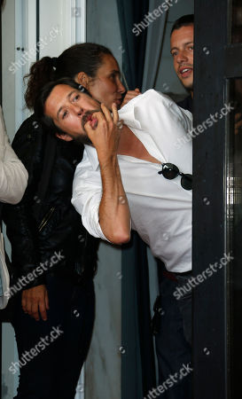 Stock Photo of Filipe Vargas Actor Filipe Vargas whistles to the press as he leaves the photo call of the film 'Linhas De Wellington' at the 69th edition of the Venice Film Festival in Venice, Italy