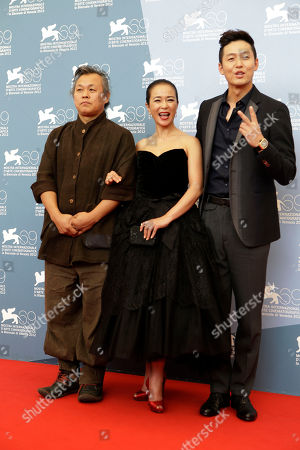 Kim Ki Duk, Cho Min Soo, Lee Jung Jin Director Kim Ki Duk, actors Cho Min Soo and Lee Jung Jin pose for the photo call of the film 'Pieta' at the 69th edition of the Venice Film Festival in Venice, Italy