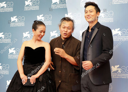 Kim Ki Duk, Cho Min Soo, Lee Jung Jin Actress Cho Min Soo, director Kim Ki Duk, and actor Lee Jung Jin pose for the photo call of the film 'Pieta' at the 69th edition of the Venice Film Festival in Venice, Italy