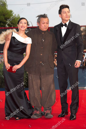 Cho Min-soo Lee Jung-Jin Kim Ki-duk From left, actress Cho Min-soo, director Kim Ki-duk, and actor Lee Jung-Jin arrive for the premiere of the movie 'Pieta' at the 69th edition of the Venice Film Festival in Venice, Italy