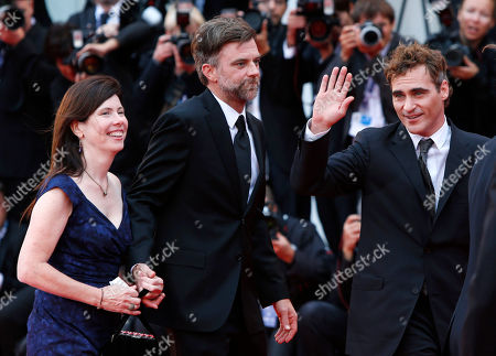 Paul Thomas Anderson, JoAnne Sellar, Joaquin Phoenix Producer JoAnne Sellar, left, director Paul Thomas Anderson, centre, and actor Joaquin Phoenix, waving to the crowd, arrive for the premiere of the movie 'The Master' at the 69th edition of the Venice Film Festival in Venice, Italy