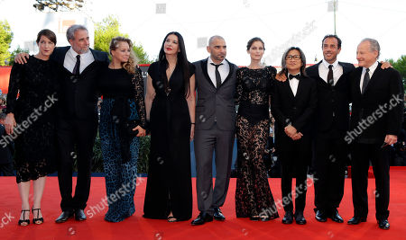 Stock Image of Marina Abramovic, Matteo Garrone, Ari Folman, Pablo Trapero, Laetitia Casta,Michael Mann, Samantha Morton, Peter Ho-Sun Chan, Ursula Meier Jury members, from left, Ursula Meier, Ari Folman, Samantha Morton, Marina Abramovic, Pablo Trapero, Laetitia Casta, Peter Ho-Sun Chan, Matteo Garrone, and President Michael Mann pose on the red carpet as they arrive for the premiere of the movie 'The Reluctant Fundamentalist' that opens the 69th edition of the Venice Film Festival in Venice, Italy