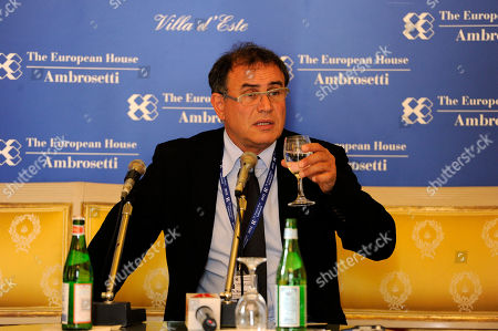 American economist Nouriel Roubini speaks during a meeting on World Economy in Cernobbio, Italy, . Experts and leaders gathered in Italy to discuss the prolonged crisis in a structurally flawed Europe, political dysfunction pushing America off a 'fiscal cliff' and the emerging economies slowdown drying up the last engine of global growth