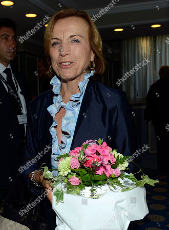 Italian Welfare Minister Elsa Fornero smiles as she leaves a meeting on World Economy in Cernobbio, Italy