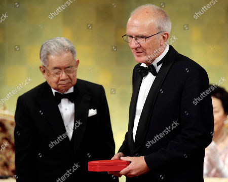 Troels Troelsen, Hitachi Denmark's architect Troels Troelsen, right, receives a medal prize on behalf of his compatriot and architect Henning Larsen from Japan's Prince Hitachi, left, during an awarding ceremony of the 24th Praemium Imperiale culture award in Tokyo