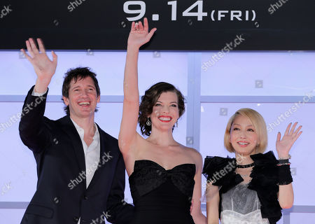 """Stock Photo of Milla Jovovich, Paul W. S. Anderson, Mika Nakashima Actress Milla Jovovich, center, her husband and director Paul W. S. Anderson, left, and Japanese actress Mika Nakashima wave during the World premiere of """"Resident Evil: Retribution"""" in Tokyo"""