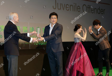 "Stock Picture of Kang Yi-kwan, Roger Corman, Lee Jung-hyun, Seo Young-ju South Korea's director Kang Yi-kwan, second from left, receives a Special Jury Prize from Jury President Roger Corman, left, along with actress Lee Jung-hyun, second from right, and actor Seo Young-ju for their film ""Juvenile Offender"" during the awarding ceremony of the 25th Tokyo International Film Festival in Tokyo"