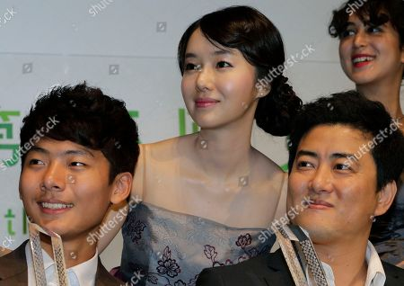 "Stock Image of Kang Yi-kwan, Lee Jung-hyun, Seo Young-ju South Korea's director Kang Yi-kwan, right, actress Lee Jung-hyun, center, and actor Seo Young-ju smile after they won a Special Jury Prize for their film, ""Juvenile Offender"" during the awarding ceremony of the 25th Tokyo International Film Festival in Tokyo"