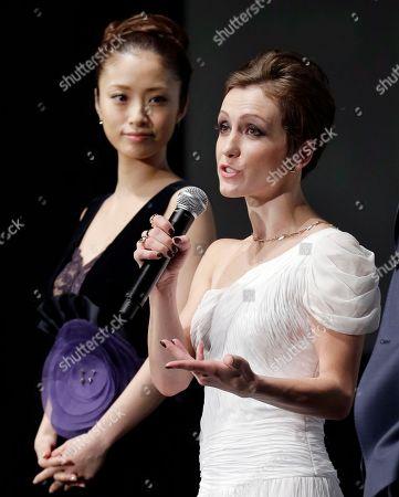 "Aya Ueto, Erica Linz Actress Erica Linz of the 3D film ""Cirque du Soleil: Worlds Away"" speaks as Aya Ueto, Japanese actress and the official navigator of the Tokyo International Film Festival, listens at the opening ceremony of the film festival, in Tokyo"