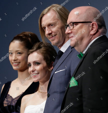 """Aya Ueto, Erica Linz, Andrew Adamson, Jacques Methe From right, executive producer Jacques Methe, director Andrew Adamson and actress Erica Linz of their 3D film """"Cirque du Soleil: Worlds Away"""" pose with Aya Ueto, Japanese actress and the official navigator of the Tokyo International Film Festival at the opening ceremony of the film festival, in Tokyo"""