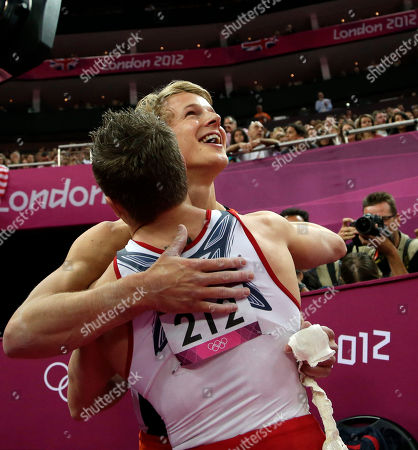 Gymnast from the Netherlands Epke Zonderland is hugged by U.S. gymnast Jonathan Horton for winning the gold medal for the horizontal bar during the artistic gymnastics men's apparatus finals at the 2012 Summer Olympics, in London