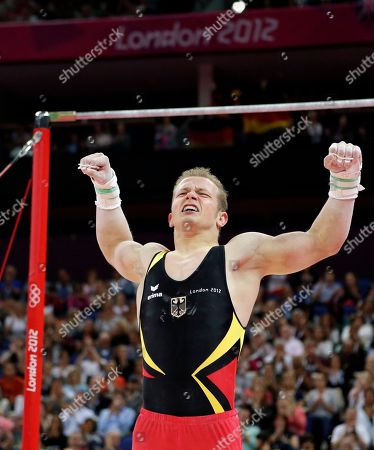 German gymnast Fabian Hambuchen celebrates after performing on the horizontal bar during the artistic gymnastics men's apparatus finals at the 2012 Summer Olympics, in London