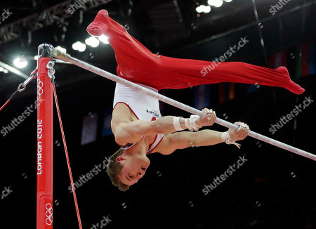 Stock Image of U.S. gymnast Jonathan Horton performs on the horizontal bar during the artistic gymnastics men's apparatus finals at the 2012 Summer Olympics, in London