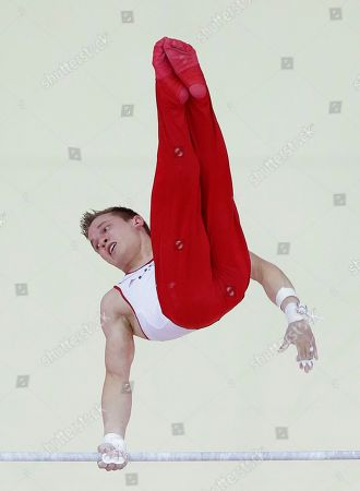 Stock Picture of U.S. gymnast Jonathan Horton performs on the horizontal bar during the artistic gymnastics men's apparatus finals at the 2012 Summer Olympics, in London