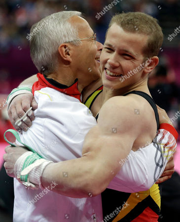 German gymnast Fabian Hambuchen hugs his coach after his performance during the artistic gymnastics men's apparatus finals for the horizontal bar at the 2012 Summer Olympics, in London