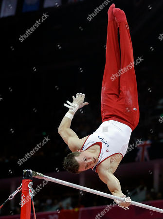 Stock Photo of U.S. gymnast Jonathan Horton performs on the horizontal bar during the artistic gymnastics men's apparatus finals at the 2012 Summer Olympics, in London