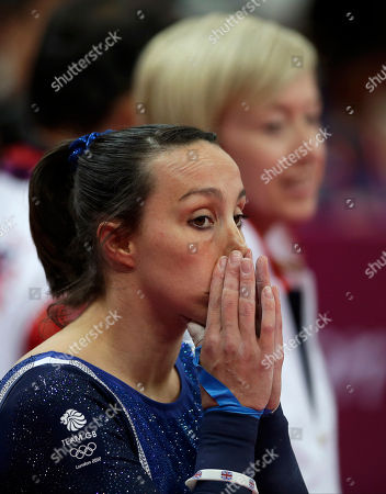Britain's gymnast Elizabeth Tweddle gestures after her performance on the uneven bars during the artistic gymnastics women's apparatus finals at the 2012 Summer Olympics, in London