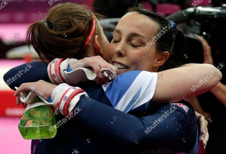 Britain's gymnast Elizabeth Tweddle, right, hugs compatriot Hannah Whelan after performing on the uneven bars during the artistic gymnastics women's apparatus finals at the 2012 Summer Olympics, in London