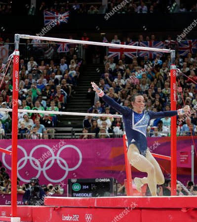 Britain's gymnast Elizabeth Tweddle take a step backwards on dismount during the artistic gymnastics women's apparatus final for the uneven bars at the 2012 Summer Olympics, in London