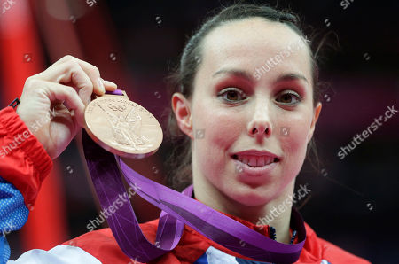 Britain's gymnast Elizabeth Tweddle displays the bronze medal for her performance on the uneven bars during the artistic gymnastics women's apparatus finals at the 2012 Summer Olympics, in London