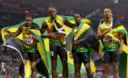 Usain Bolt Jamaica's Yohan Blake, Usain Bolt, Nesta Carter, and Michael Frater pose with their national flag after their gold medal win in the men's 4 x 100-meter relay during the athletics in the Olympic Stadium at the 2012 Summer Olympics, London, . Jamaica set a new world record with a time of 36.84 seconds