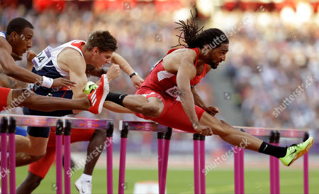 United States' Jason Richardson leads Cuba's Orlando Ortega and Britain's Lawrence Clarke during their men's 110-meter hurdles semifinal during the athletics in the Olympic Stadium at the 2012 Summer Olympics, London