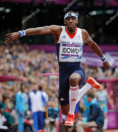 Britain's Phillips Idowu competes in the men's triple jump qualification round during the athletics in the Olympic Stadium at the 2012 Summer Olympics, London