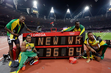 Usain Bolt From left, Jamaica's Usain Bolt, Jamaica's Yohan Blake, Jamaica's Nesta Carter and Jamaica's Michael Frater pose for photographers next to a timing board displaying their world record time of 36.84 seconds for the men's 4x100-meter relay final during the athletics in the Olympic Stadium at the 2012 Summer Olympics, London