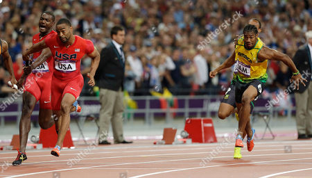 From left, United States' Justin Gatlin hands the baton to Tyson Gay, as Jamaica's Michael Frater hands the baton to Yohan Blake in the men's 4x100-meter relay final during the athletics in the Olympic Stadium at the 2012 Summer Olympics, London