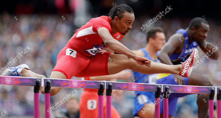 United States' Aries Merrit clears a hurdle in a men's 110-meter hurdles heat during the athletics in the Olympic Stadium at the 2012 Summer Olympics, London