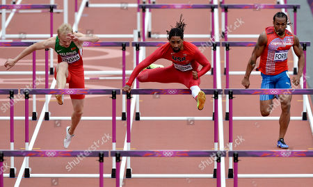 Belarus' Maksim Lynsha, left, United States' Jason Richardson, center, and Cayman Islands' Ronald Forbes, right, compete in a men's 110-meter hurdles heat during the athletics in the Olympic Stadium at the 2012 Summer Olympics, London