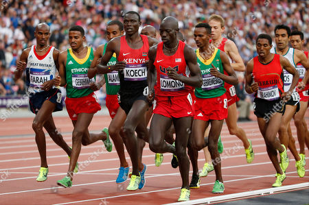 From front left, Britain's Mo Farah, Ethiopia's Hagos Gebrhiwet, Ethiopia's Yenew Alamirew, Kenya's Isiah Kiplangat Koech, United States' Lopez Lomong, and Ethiopia's Dejen Gebremeskel compete in the men's 5000-meter final during the athletics in the Olympic Stadium at the 2012 Summer Olympics, London