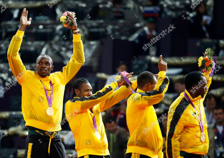 Usain Bolt From left, Jamaica's Usain Bolt, Jamaica's Yohan Blake, Jamaica's Michael Frater and Jamaica's Nesta Carter celebrate after receiving their gold medals for the men's 4x100-meter relay during the athletics in the Olympic Stadium at the 2012 Summer Olympics, London, . Jamaica set a new world record with a time of 36.84 seconds